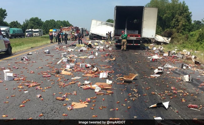 Fireball whisky covers interstate after big rigs crash in Arkansas