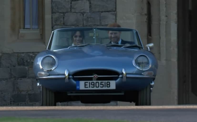 royal couple takes their first drive in a classic jaguar with a