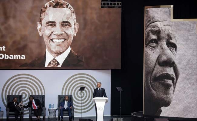 Barack Obama Warns Of 'Uncertain Times' In Nelson Mandela Tribute