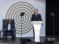 "Barack Obama Warns Of ""Uncertain Times"" In Nelson Mandela Tribute"
