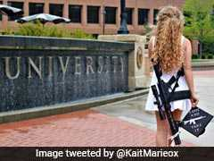 Story Behind The Viral Photo Of Girl Posing With Rifle At Her Graduation