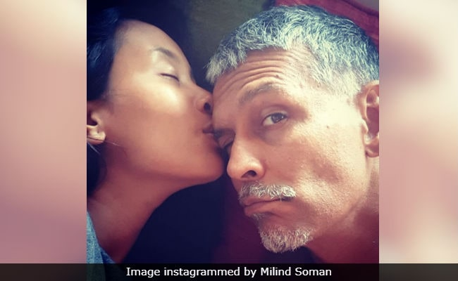 Image result for actor milind soman and wife romantic photo