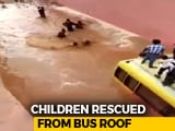 Video : Watch: Rajasthan Students Rescued After Bus Gets Stuck On Flooded Road
