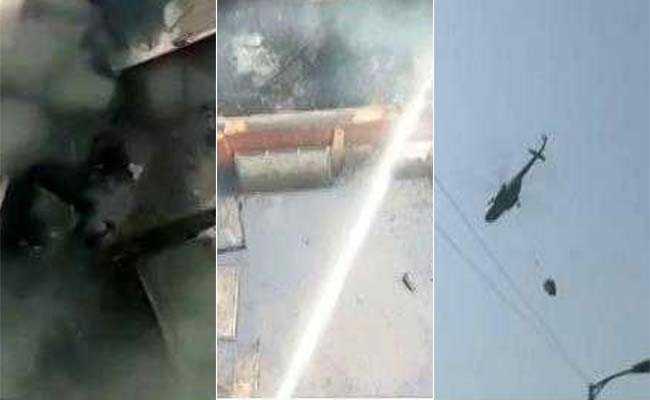 मालवीय नगर आग हादसा: इन तस्वीरों में देखें कैसे एयरफोर्स के MI 17 हेलीकॉप्टर ने भीषण आग को बुझाया