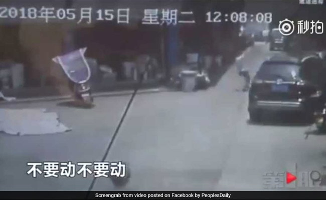 Video: Man Runs To Catch Girl Falling From 2 Storey Building In China