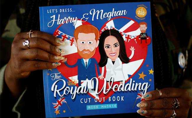 Ishea Brown holds a Harry and Meghan book at her Seattle apartment
