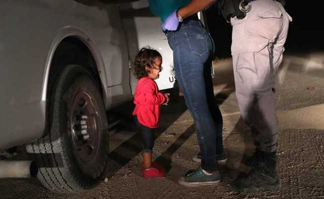Donald Trump faces backlash amid photos of caged migrant children