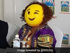 Multi-Million Lottery Winner Shows Up In Emoji Mask To Hide Identity