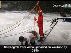 Watch: Driver Rescued From Middle Of Flooded River In China