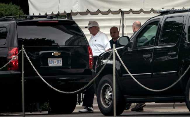Donald Trump At His Golf Course As John McCain Funeral Underway