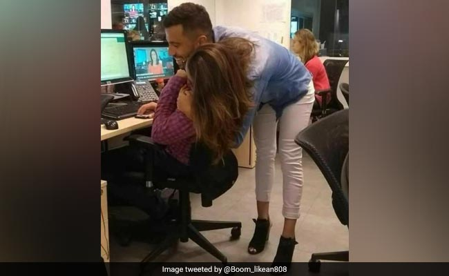 This Pic Of People Hugging Will Leave You Very, Very Confused. Take A Look