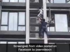 In China, Superdad Rescues Son, 7, Dangling From Seventh Floor