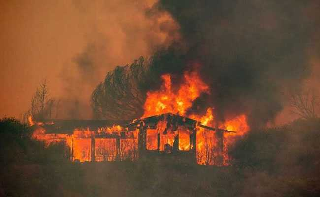 California wildfires: Six killed as hundreds of homes destroyed