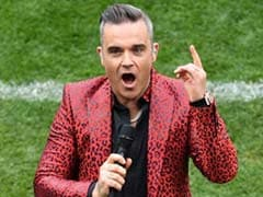 Football World Cup Kicks Off With Robbie Williams' Obscene Gesture