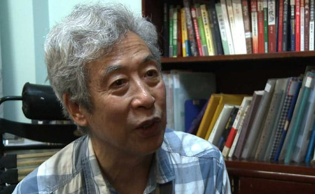 'Police Are Here...': China Critic Disappears During Live Interview