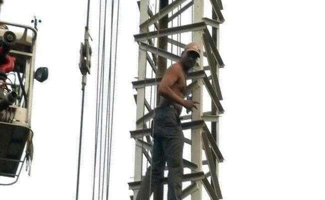 Man Threatens To Jump Off 300-Feet Tall Crane In Delhi