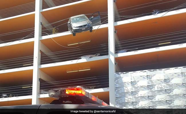 Car Hangs From 4th Floor Parking. Driver Hit Accelerator By Mistake