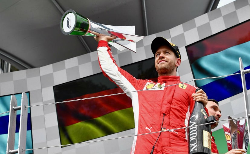 Formula One: Vettel claims 50th win and goes top in title race
