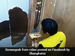 Caught On Camera: Chinese Delivery Man Eats Customer's Meal, Fired