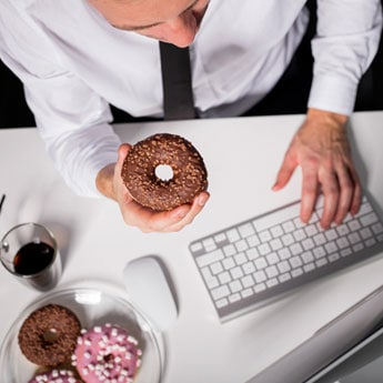 Why You Should Probably Stop Snacking At Work