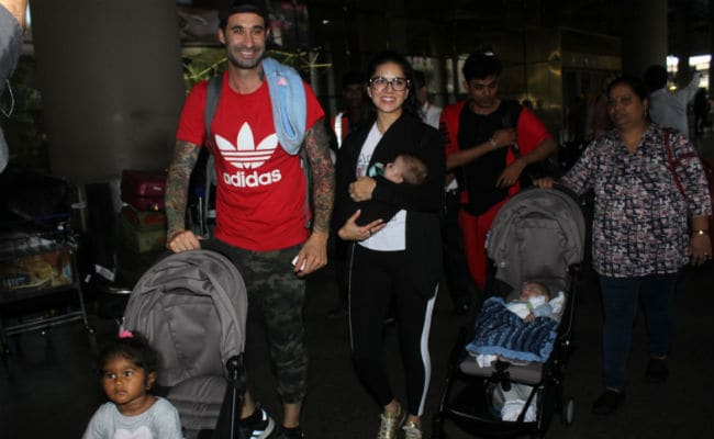 Sunny Leone, Husband Daniel Weber Bring Daughter Nisha And Twins To Mumbai. See Pics At Airport