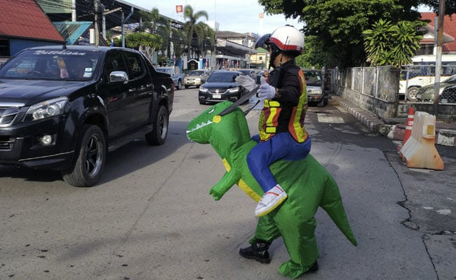 Cop Dons T-Rex Costume To Teach Traffic Safety Lessons