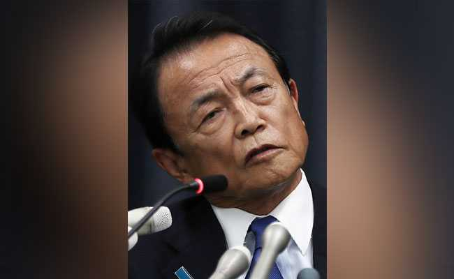 Japan Minister Taro Aso Returns Year's Salary Over Scandal Involving PM Shinzo Abe