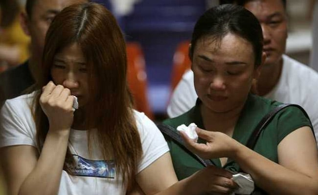 Chinese Relatives Wait For News After Thai Tourist Boat Sinking