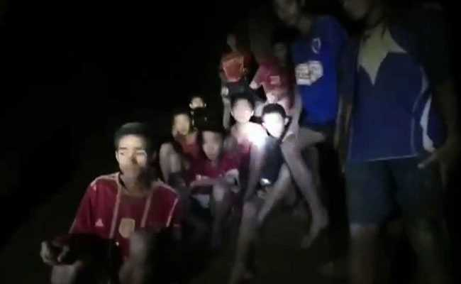 Four boys rescued from Thailand cave; eight delayed 10-20 hours