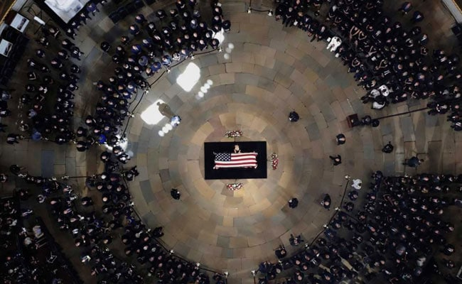 for john mccains last tribute barack obama and george bushs eulogy