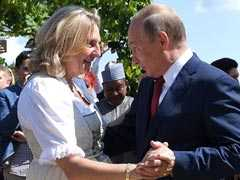 At Austrian Minister's Wedding, Vladimir Putin Brings Music And Flowers