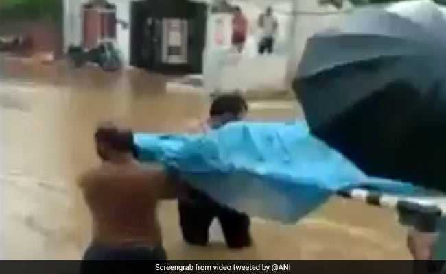 No Ambulance, Pregnant Woman Carried On Cot Through Flooded Streets