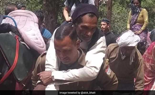 Another Uttarakhand Cop Turns Saviour, Carries Ill Pilgrim To Hospital On Back