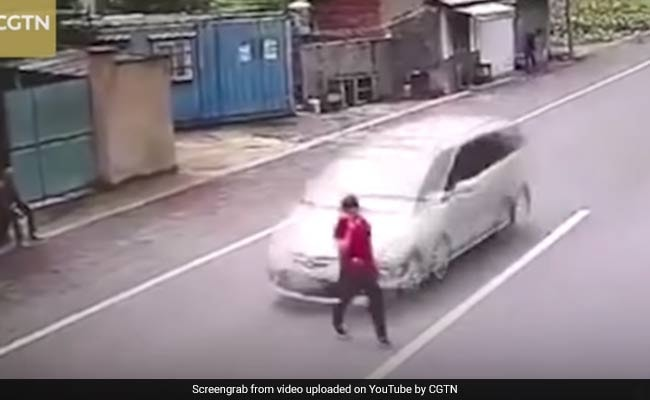Speeding Car Grazes Woman Crossing Road. All She Loses Is Her Shoe, Phone